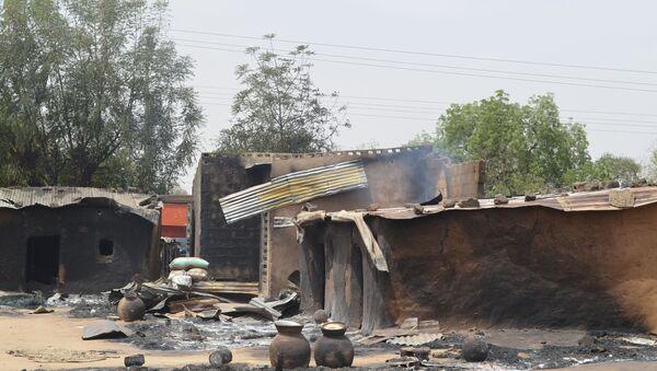 This photo shows razed homes in Mainok, outside Maiduguri, Borno State, Nigeria, on March 6, 2014 - Sputnik International