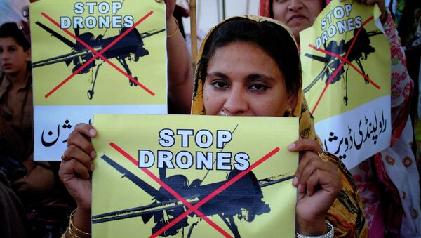 Pakistani women rally against the US drone strikes in tribal areas. - Sputnik International