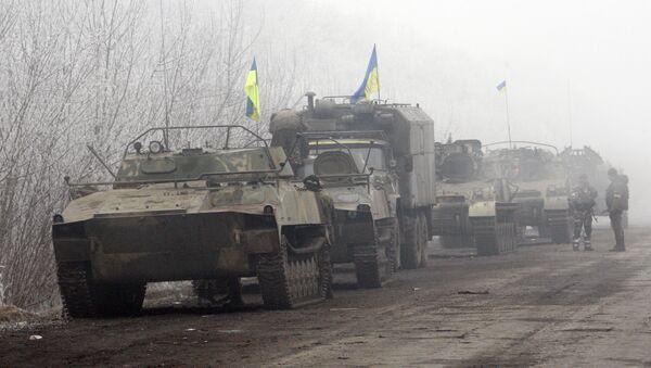 Ukrainian forces vehicles are seen parked on a road between Artemivsk and Debaltseve, Donetsk region, on February 15, 2015 - Sputnik International