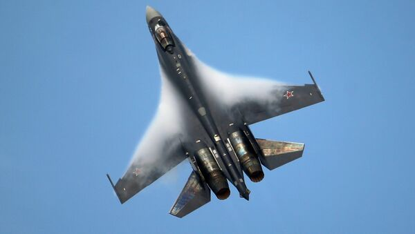 A Sukhoi SU-35 jetfigther performs its demonstration flight during the 50th Paris Air Show at Le Bourget airport, north of Paris - Sputnik International