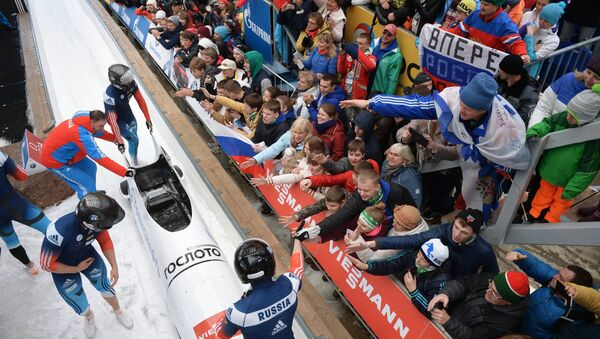 Nikita Zakharov, Maxim Mokrousov, Kirill Antyukh and Vasily Kondratenko (Russia) at the finish of a heat during the four man bob event at the Bobsleigh World Cup 8 in Sochi - Sputnik International