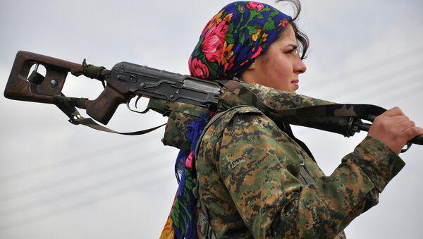 A Kurdish female fighter of the Women's Protection Units (YPJ) looks on at a training camp in al-Qahtaniyah, near the Syrian-Turkish border - Sputnik International