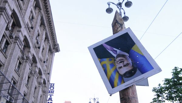 Portrait of ousted Ukrainian President Viktor Yanukovych on Independence Square in Kiev - Sputnik International