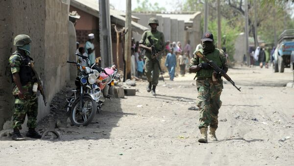 Soldiers walk in the street in the remote northeast town of Baga, Borno State. - Sputnik International