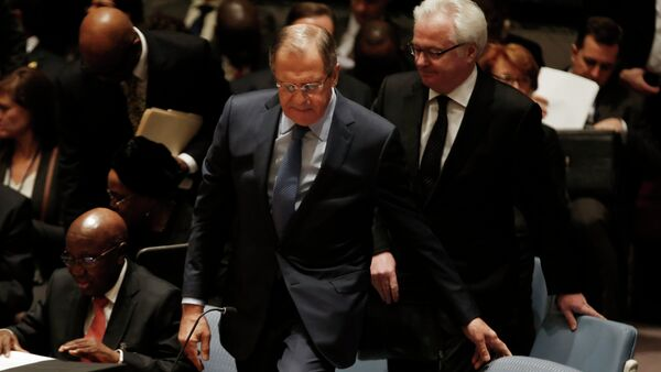 Russian Foreign Minister Sergey Lavrov takes his seat for a meeting of the United Nations Security Council at the U.N. headquarters in New York, February 23, 2015. At right is Russian Ambassador to the United Nations Vitaly Churkin - Sputnik International