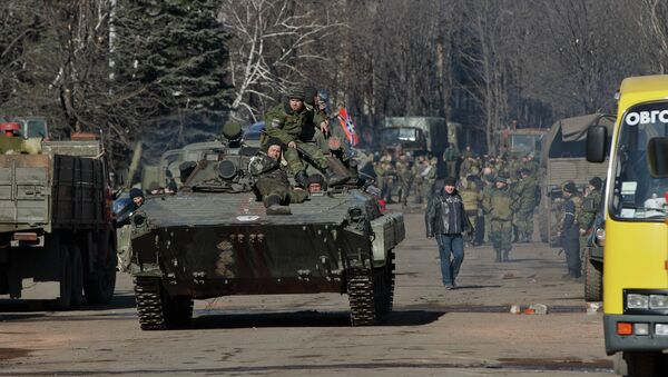 Independence supporters ride on an armored vehicle in the center of Debaltseve, Ukraine, Monday, Feb. 23, 2015 - Sputnik International