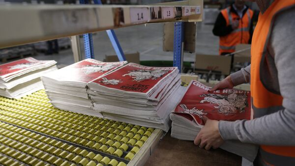 An employee checks the forthcoming edition of the weekly newspaper Charlie Hebdo, on February 24, 2015 in Villabe, south of Paris - Sputnik International