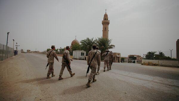 US Marines from Battalion Landing Team, 22nd Marine Expeditionary Unit, walk nearby a mosque in the desert of Jebel Petra, near Aqaba seaport, south of Amman, Jordan - Sputnik International