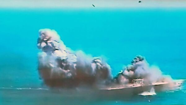 This image taken from Iranian state TV, shows damage to a mock U.S. aircraft carrier during large-scale naval and air defense drills by Iran's Revolutionary Guard, near the Strait of Hormuz, Iran - Sputnik International