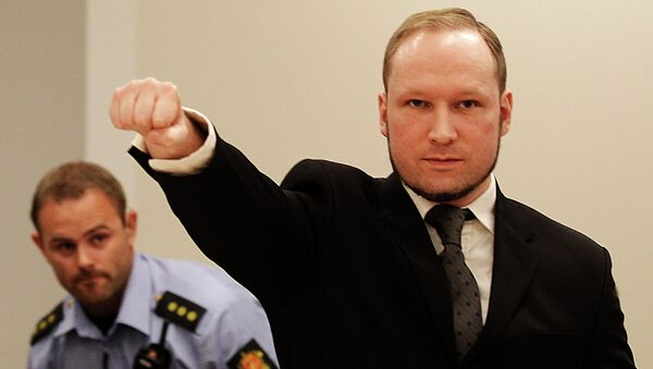Anders Behring Breivik, makes a salute after arriving in the court room at a courthouse in Oslo - Sputnik International