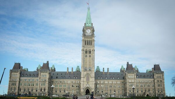 The Canadian Parliament is seen on October 23, 2014, in Ottawa, the day after multiple shootings in the capital city and Parliament buildings left a soldier dead and others wounded - Sputnik International