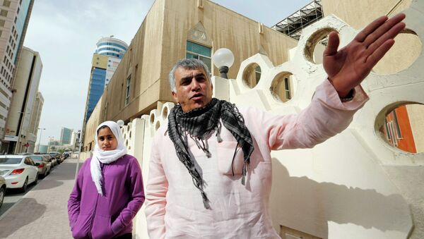Human rights activist Nabeel Rajab (R) gestures as he walks with his daughter Malak Rajab to attend his appeal hearing at court in Manama, February 11, 2015 - Sputnik International