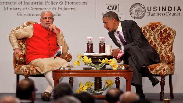 U.S. President Barack Obama, right leans towards Indian Prime Minister Narendra Modi to talk to him during the India-U.S business summit in New Delhi, India, Monday, Jan. 26, 2015. - Sputnik International