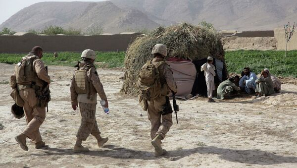 The US military compensated Afghan families for civilian deaths and injuries as part of its counterinsurgency strategy, which rests upon winning support of the local population, according to a report published by the online publication The Intercept - Sputnik International