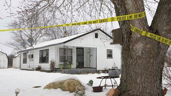 Police tape surrounds one of the crime scenes where gunman, Joseph Jesse Aldridge, killed seven people on Thursday night in Tyrone, Missouri - Sputnik International