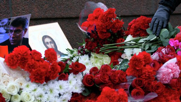 People place flowers on February 28, 2015 at the spot, where Russian opposition leader Boris Nemtsov was shot dead, near Saint-Basil's Cathedral, in the center of Moscow. - Sputnik International