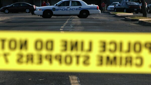 In this 2008 file photo, police taped off a portion of a parking lot behind Sharpstown Mall in Houston. - Sputnik International