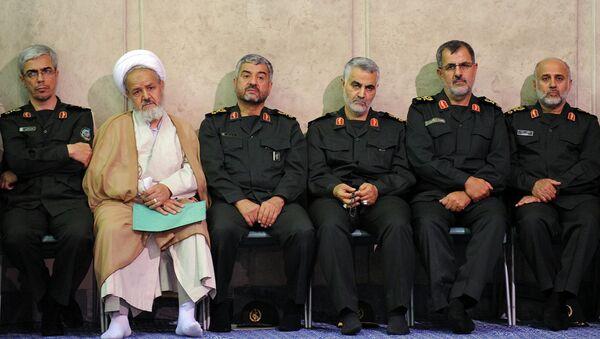 Gen. Qasem Soleimani, third right, sits next to the commander of the Revolutionary Guard, Mohammad Ali Jafari, third left, in a meeting of the commanders of the Revolutionary Guard with Supreme Leader Ayatollah Ali Khamenei in Tehran, Iran.  - Sputnik International