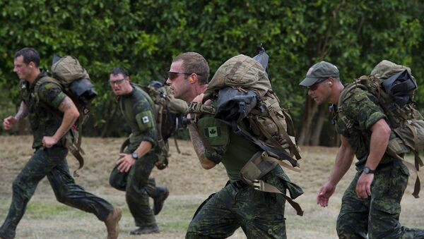 Canada's special forces soldiers take part at the Acuatic tactics during 9th edition of the commando forces competition at the military base of Tolemaida, Colombia - Sputnik International