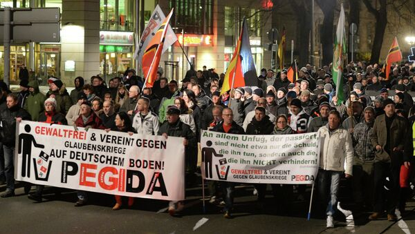 People march during a demonstration of the socalled movement of Patriotic Europeans Against the Islamisation of the Occident aka Pegida, in Dresden - Sputnik International