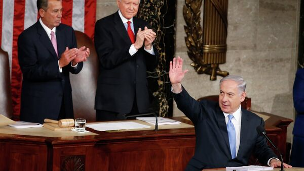 Israeli Prime Minister Benjamin Netanyahu waves as he steps to the podium prior to speaking before a joint meeting of Congress on Capitol Hill. - Sputnik International