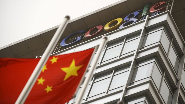 A Chinese flag flies next to the Google company logo outside the Google China headquarters in Beijing on March 22, 2010 - Sputnik International