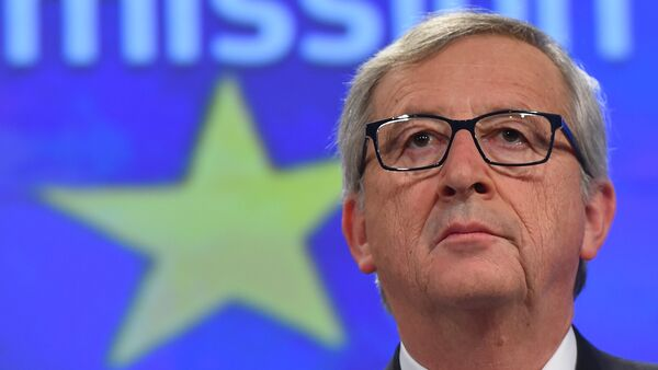European Commission President Jean-Claude Juncker gives a press conference at the end of German chancellor's visit to the European Commission at the European Commission headquarters in Brussels, on March 4, 2015 - Sputnik International