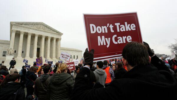 Demonstrators in favor of Obamacare gather at the Supreme Court building in Washington March 4, 2015 - Sputnik International