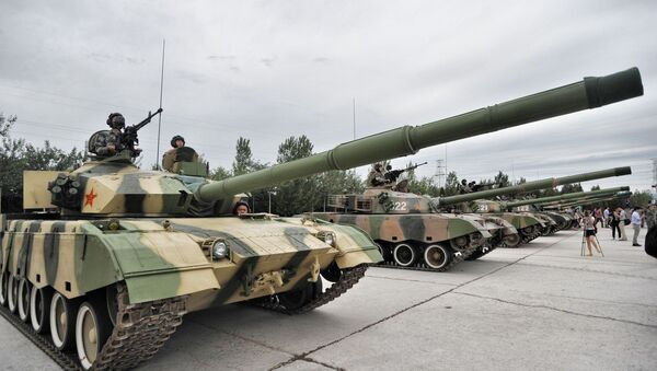 Chinese soldiers pose in tanks during a training session at the Academy of Armored Forces Engineering of the Peoples Liberation Army (PLA) in Beijing, China, 22 July 2014 - Sputnik International