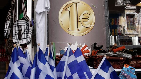 Greek national flags are displayed for sale at the entrance of a one Euro shop in Athens - Sputnik International
