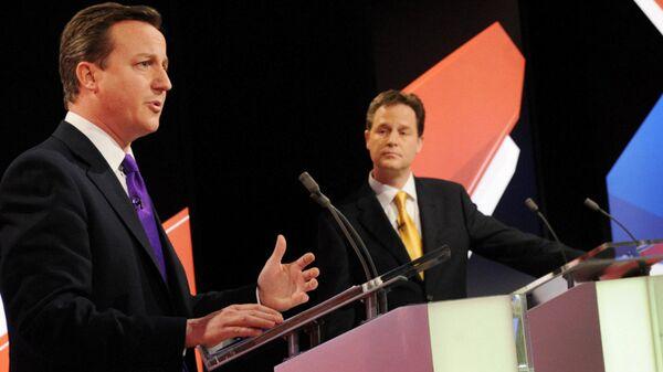 Conservative leader David Cameron, left, and Liberal Democrat Party leader Nick Clegg, centre, take part in Britain's second televised election debate in Bristol, England, Thursday, April 22, 2010. - Sputnik International