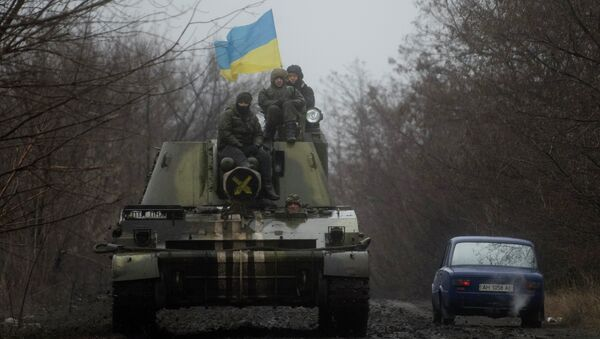 Ukrainian servicemen ride atop an armored vehicle with a Ukrainian flag, on the outskirts of Donetsk, Ukraine - Sputnik International
