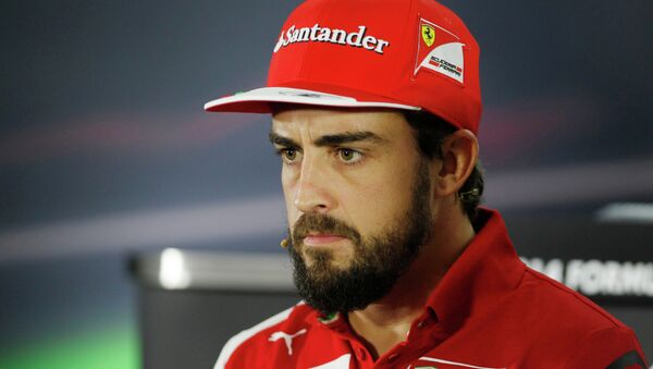 Ferrari driver Fernando Alonso of Spain answers to reporters during a news conference at the Yas Marina racetrack in Abu Dhabi, United Arab Emirates, Thursday, Nov. 20, 2014. Two-time Formula One champion Fernando Alonso is leaving Ferrari after the final race of the season and will be replaced by four-time champion Sebastian Vettel. The 33-year-old Spanish driver had said earlier this season that his future was elsewhere, likely at McLaren. - Sputnik International