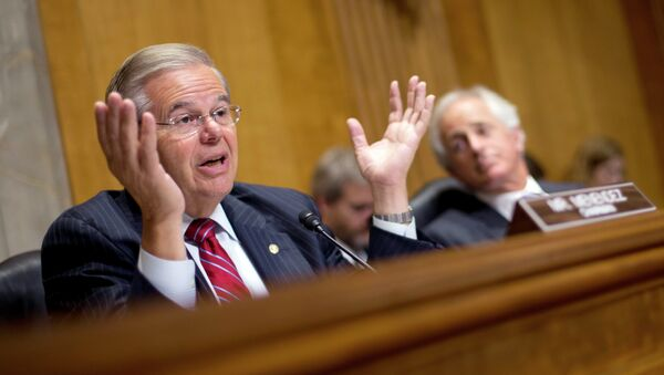 Chairman of the Senate Foreign Relations Committee, Sen. Robert Menendez, D-NJ., left, gestures as he speaks as ranking member Sen. Bob Corker, R-Tenn., sits right, during a hearing on Capitol Hill in Washington, Wednesday, July 9, 2014, to examine Russia and developments in Ukraine. - Sputnik International