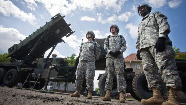 US soldiers stand on May 26, 2010 in front of a Patriot missile battery at an army base in the northern Polish town of Morag - Sputnik International