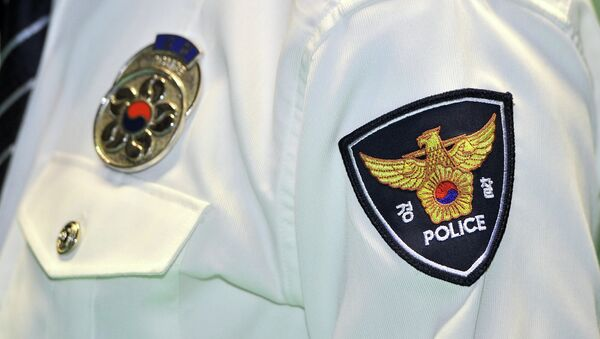 A logo of South Korean National Police Agency is seen on an arm of a policeman during a ceremony at a gymnasium in Seoul on February 15, 2012 - Sputnik International