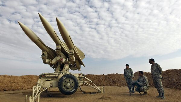 In this photo obtained from the Iranian Mehr News Agency, Iranian army members prepare missiles to be launched, during a maneuver, in an undisclosed location in Iran - Sputnik International