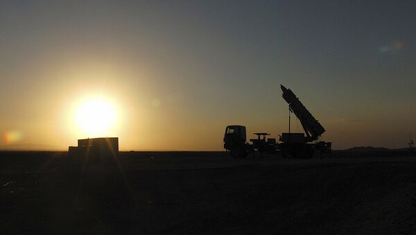 This photo released on Saturday, Nov. 9, 2013 by the Iranian Defense Ministry claims to show an air defense system with Sayyad-2 missiles prepared to be launched in an undisclosed location in Iran. - Sputnik International