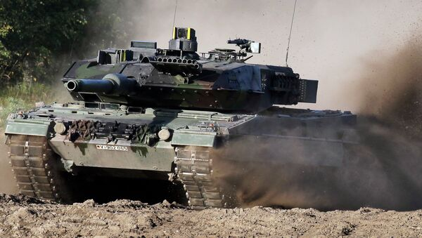 A Leopard 2 tank is pictured during a demonstration event held for the media by the German Bundeswehr in Munster near Hannover, Germany. (File) - Sputnik International