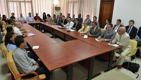 Colombia's government negotiators attend peace talks with the FARC guerrillas negotiators in Havana March 5, 2015 - Sputnik International