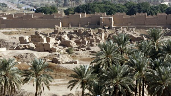 A view of the newly constructed (back) and ruins (foreground) of the ancient city of Babylon, some 100 kms south of Baghdad, on November 27, 2008 - Sputnik International