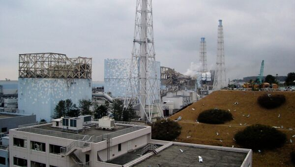 In this image released by Tokyo Electric Power Co., smoke billows from the No. 3 unit among four housings cover four reactors at the Fukushima Dai-ichi nuclear complex in Okumamachi, Fukushima Prefecture, northeastern Japan, on Tuesday, March 15, 2011 - Sputnik International