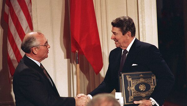 Dec. 8, 1987, file photo, U.S. President Ronald Reagan, right, shakes hands with Soviet leader Mikhail Gorbachev after the two leaders signed the Intermediate Range Nuclear Forces Treaty - Sputnik International