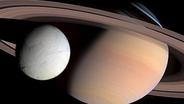 Saturn and Enceladus - Sputnik International