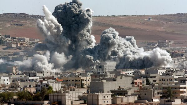 In this Monday, Nov. 17, 2014 file photo, smoke rises from the Syrian city of Kobani, following an airstrike by the U.S.-led coalition, seen from a hilltop outside Suruc, on the Turkey-Syria border. - Sputnik International