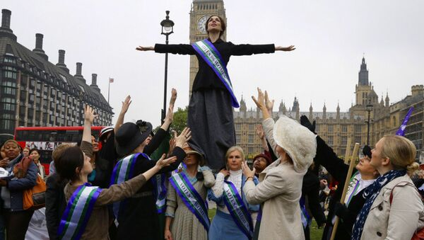 Women's rights activists from the UK Feminista organization, some dressed as suffragettes, stage a photo for the benefit of the media across the Houses of Parliament - Sputnik International