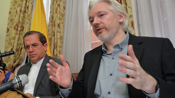 Julian Assange, with Ecuadorian Foreign Minister Ricardo Patiño, said in an Aug. 8 2014 press conference that he would be leaving the embassy soon, though denied he was going to hand himself over to British police. - Sputnik International