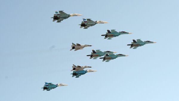 A group of 10 aircraft: Sukhoi 34 aircraft, Sukhoi 27 aircraft and MiG 29 aircraft - Sputnik International