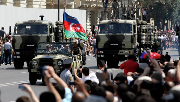Military vehicles make their way down a road during a military parade marking Armed Forces Day in Baku, Azerbaijan, in 2011. - Sputnik International