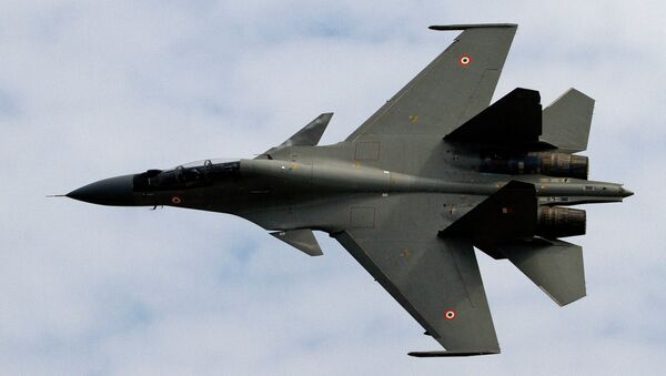 Indian Air Force (IAF) Sukhoi Su-30 fighter aircraft flies past during a parade at an airbase in Tezpur, India, Friday, Nov. 21 2014 - Sputnik International